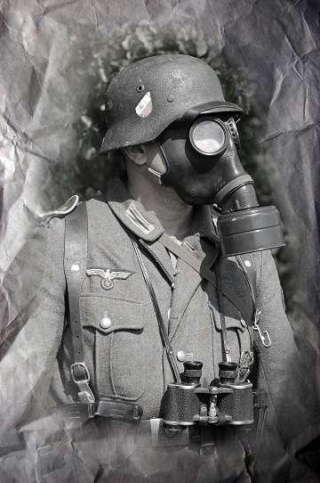 German soldier in gas-mask. WW2 reenacting