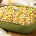 Chicken Noodle Casserole in a green baking dish on a wooden surface