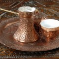 turkish coffee pot and cups on brown wooden table