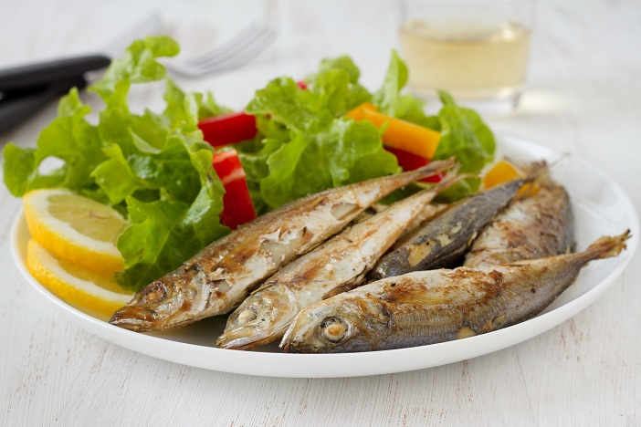 fried fish with lemon and salad