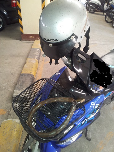 Note the padlock and chain are probably more costly than the helmet