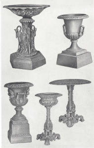 IRON URNS AND A GARDEN TABLE