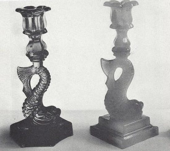 Old and new dolphin candlestick